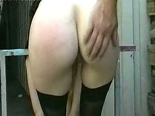 Milf slave with big tits gets naked and spanked on her pussy