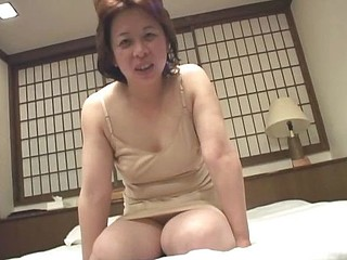 Married old Asian granny is blindfolded as that babe masturbates her censored twat