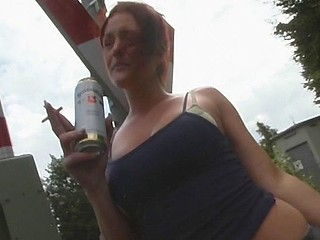 German whore and her partner go behind the bushes to fuck