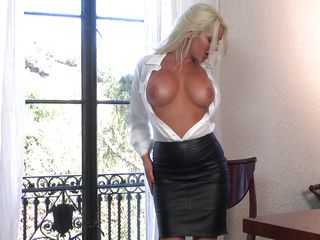 horny blonde takes off her leather skirt and masturbates