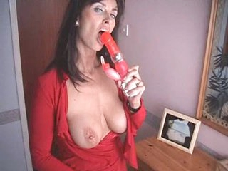 British MILF fucks herself with a pair of high heeled shoe