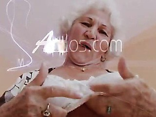 Big titted grandma plays with her boobs and her old cunt