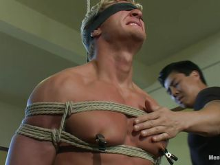 tied muscled blonde gay receives his treatment