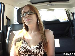 blonde giving blowjob on back seat
