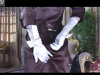 Glam playgirl putting on vintage six-strap stockings with a fancy hat and gloves