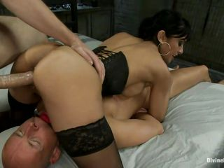 The hairless dude is in large trouble and he likes it a lot! A dark brown milf with large breasts, shaved vagina and sexy ass is dominating him and receives a guy's cock in her pussy at the same time. She enjoys being between two hard dicks and loves to be fucked while she sits on another man. Will she receive sperm from both of them?