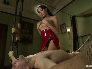 gorgeous shemale wearing red dress and a cute tied boy
