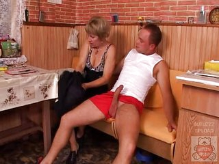 Mature mother and the Son&amp,#039,s friend have a good time on kitchen.