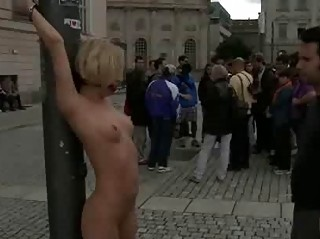 Blonde bound and nude in public