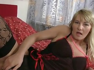 Sexy golden-haired cougar round massive natural tits gets naked off her underware and gives her..