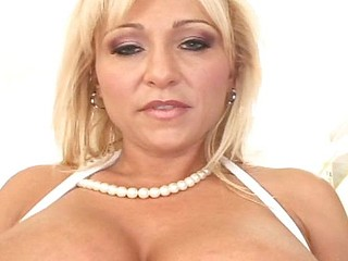 Sexy blonde MILF with huge tits and pierced nipples gets a delivery in the backdoor