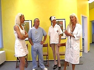 Hot blonde nurse gets it on with an old ribald doctor on the floor
