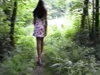 Cute brunette goes walking in the woods naked and takes a pee