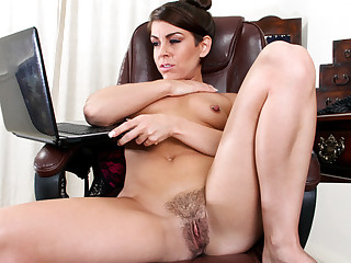 Amazing office milf peels off her pantyhose and uses both hands to give her swollen hairy pussy..