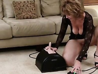 Glamorous cougar thoroughly enjoys her first sybian ride