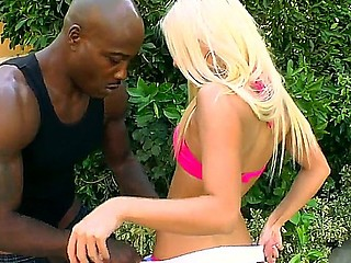 Blonde hottie Jessie Volt kneels and deep blows this darksome dudes huge cock